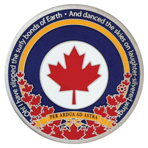 One side of the Royal Canadian Air Force coin pictured.  It is antique silver with blue and yellow borders around a red maple leaf on a white background.