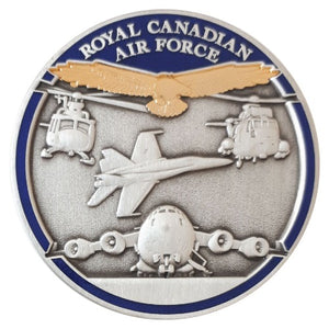 Opposite side of Royal Canadian Air Force coin with 3D antique silver jet, airplane and two helicopters as well as a polished gold eagle and a blue border