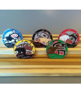 Picture of 5 British Columbia non trackable geocoins in a bamboo stand