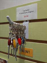 Multiple nano log rollers with various coloured beads displayed in our store.  The sign behind them says $6.99 each