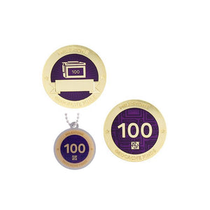 Milestone geocoin in gold with purple paint for your 100th find.  Front and back pictured, as well as the matching tag.