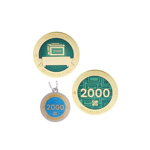 Milestone geocoin in gold with turquoise paint for your 2000th find.  Front and back pictured, as well as the matching tag.