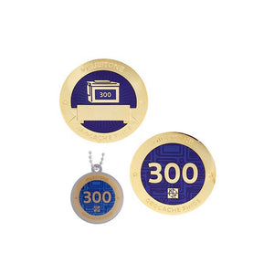 Milestone geocoin in gold with indigo paint for your 300th find.  Front and back pictured, as well as the matching tag.