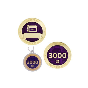 Milestone geocoin in gold with purple paint for your 3000th find.  Front and back pictured, as well as the matching tag.