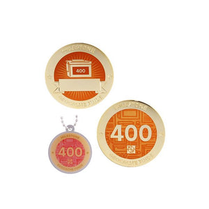 Milestone geocoin in gold with orange paint for your 400th find.  Front and back pictured, as well as the matching tag.