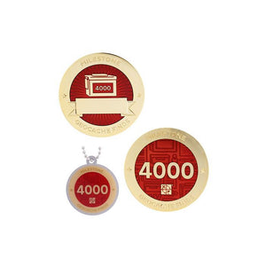 Milestone geocoin in gold with red paint for your 4000th find.  Front and back pictured, as well as the matching tag.