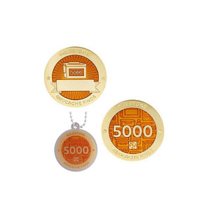 Milestone geocoin in gold with orange paint for your 5000th find.  Front and back pictured, as well as the matching tag.