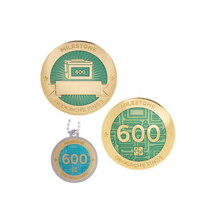 Milestone geocoin in gold with turquoise paint for your 600th find.  Front and back pictured, as well as the matching tag.