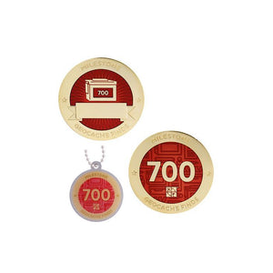 Milestone geocoin in gold with dark red paint for your 700th find.  Front and back pictured, as well as the matching tag.