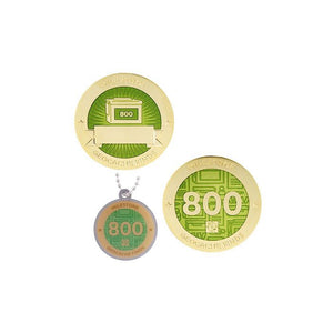 Milestone geocoin in gold with light green paint for your 800th find.  Front and back pictured, as well as the matching tag.