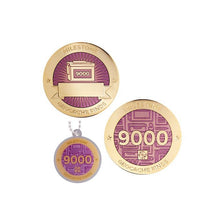 Milestone geocoin in gold with pink paint for your 9000th find.  Front and back pictured, as well as the matching tag.