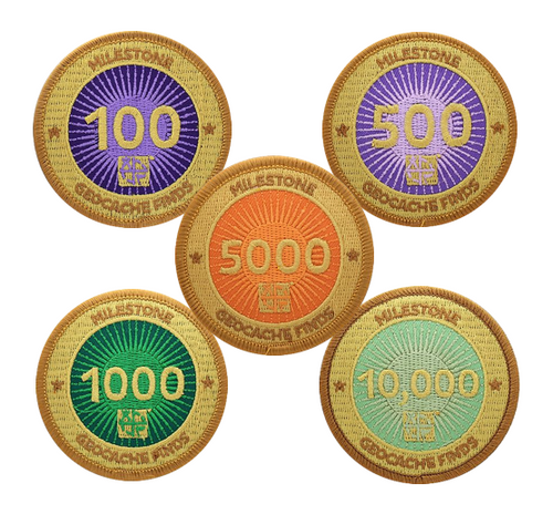 Image of 5 patches with a gold background and multiple colours behind different milestone finds.  Quantities are 100, 500, 1000, 5000 and 10000.