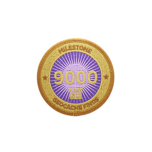 Gold patch with a purple background for 9000 finds