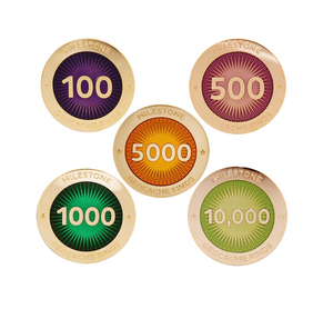 Five milestone pins pictured, all polished gold, for amounts of 100, 500, 1000, 5000 and 10000