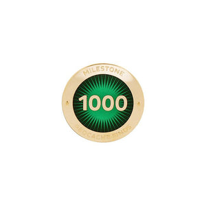 Gold pin for 1000 finds in dark green