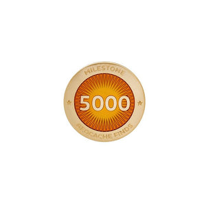 Gold pin for 5000 finds in orange