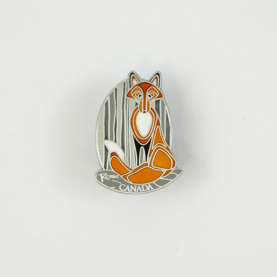 Oval shaped silver pin with an orange fox on it.