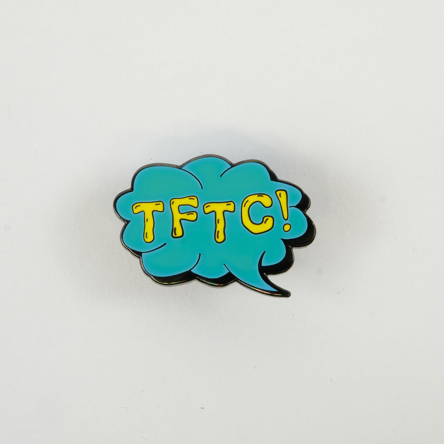 Turquoise glow in the dark TFTC pin