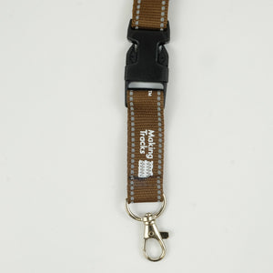 Close up of black clip on brown lanyard and lobster claw