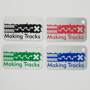 4 Making Tracks tags in black, pink, green and blue