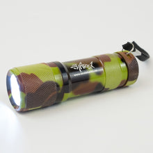 Camouflage print flashlight with the Sharkz logo and the light on