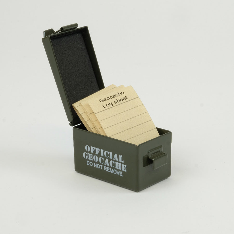 Green micro ammo can cache, open with log sheets in it