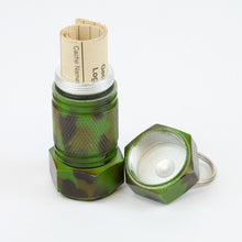 Camo mighty-mini aluminum cache with logbook rolled up inside of it