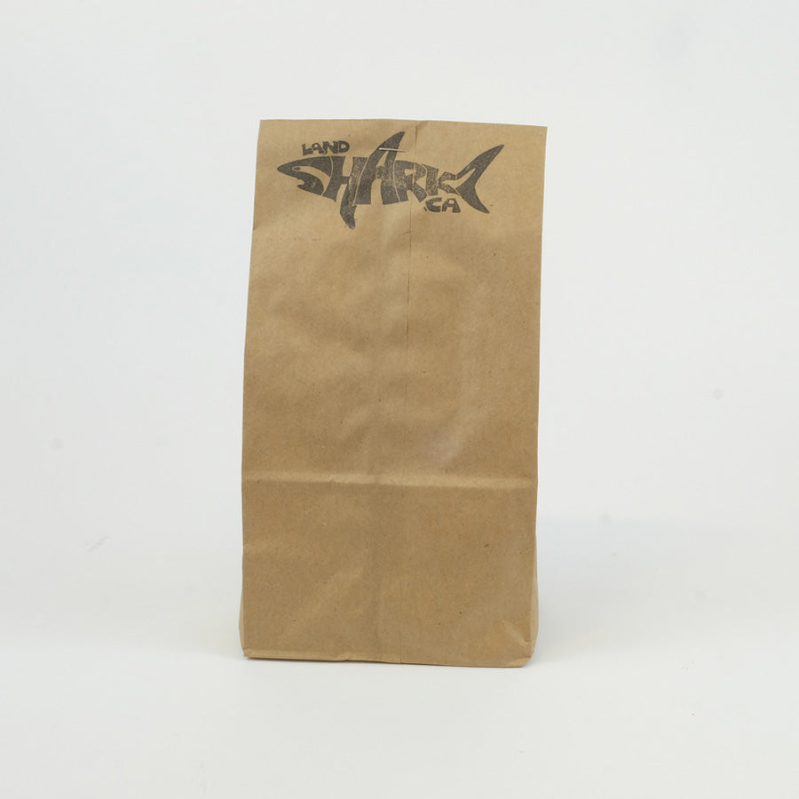 Brown paper bag with the Landsharkz.ca logo stamped on the top.