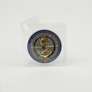 Single PVC pouch holding the Navy challenge coin
