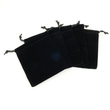 Five black velvet draw string bags fanned out
