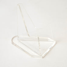 Close up of transparent acrylic coin stand