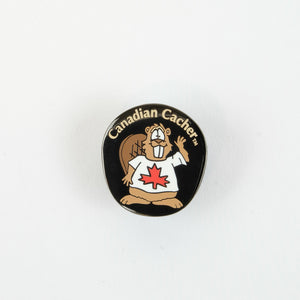 Small black enamel pin with the Canadian Cacher Beaver Dude cartoon on the front