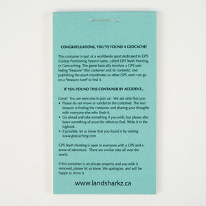 The back of the turquoise logbook which has an explanation for people who don't geocache regularly.