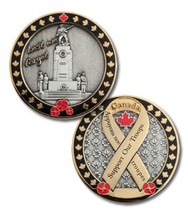 "Both sides of the Support Our Troops coin pictured.  One side has four soldiers bowing their heads in remembrance.  It has a black border with gold maple leaves and poppies.  The other side has a gold ribbon that says ""support our troops"" in English and French, with the same black border with gold maple leaves and poppies."