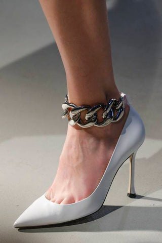 White pump with chain accented ankle strap