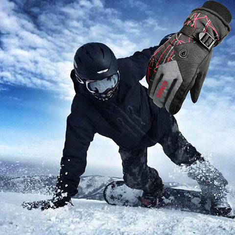 man snowboarding with ski gloves