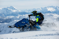 how to ride a snowmobile properly