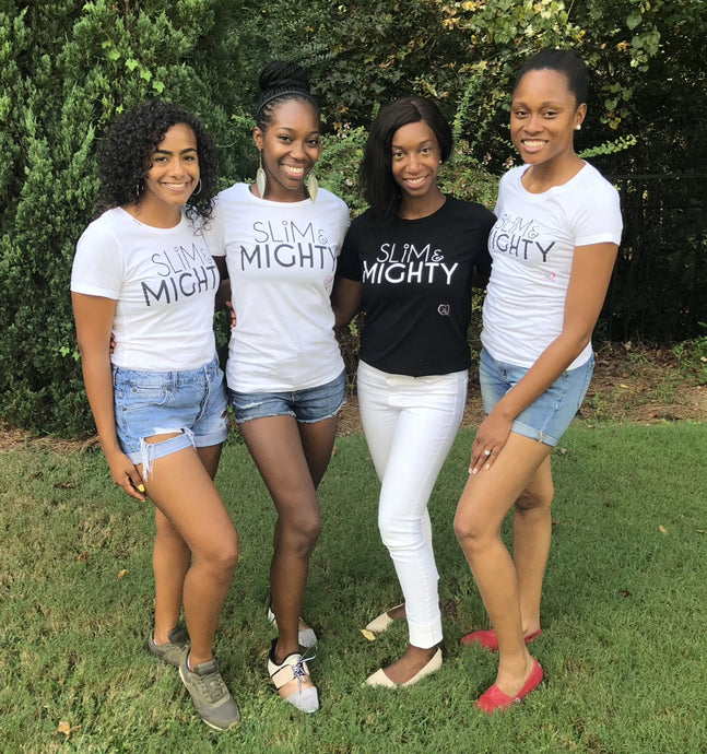 Four women gathered together wearing slim & mighty t-shirts in black and white