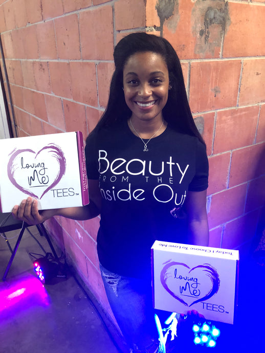 woman wearing beauty from the inside out t-shirt in black with white font