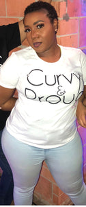 woman wearing curvy & proud t-shirt in white with black font