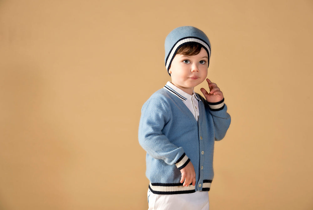 Boy wearing Oscar and Me light blue cashmere cardigan and beanie