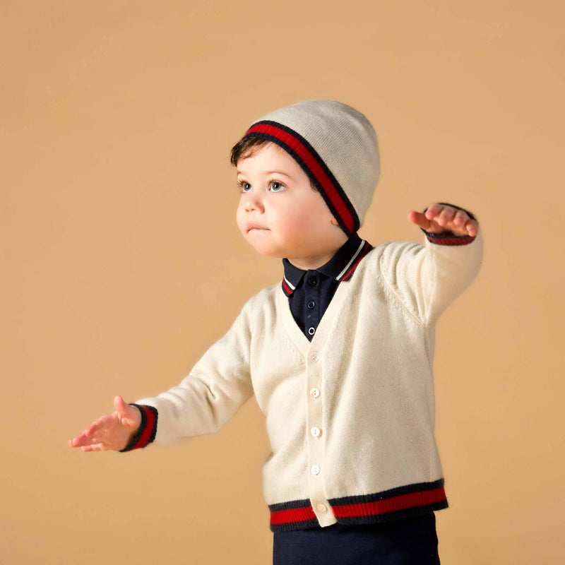 Boy wearing Oscar and Me cream cashmere cardigan and beanie