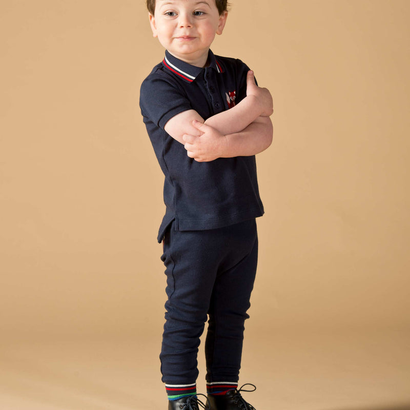 Boy wearing Oscar and Me Mr. Fox pima cotton navy polo and pants