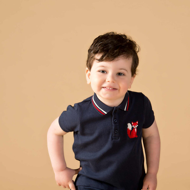 Boy wearing Oscar and Me Mr. Fox navy pima cotton polo
