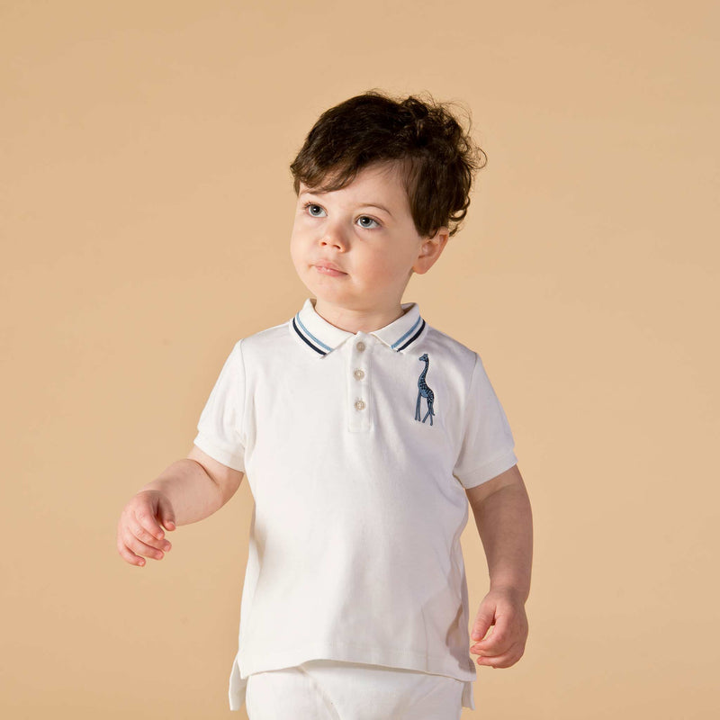 Boy wearing Oscar and Me pima cotton white polo and pants
