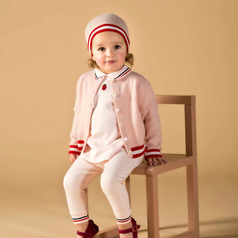 Girl wearing Oscar and Me pink cashmere cardigan and beanie
