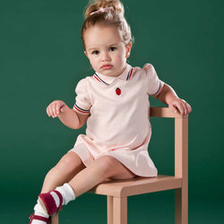 Girl wearing Oscar and Me pima cotton pink dress and bloomers