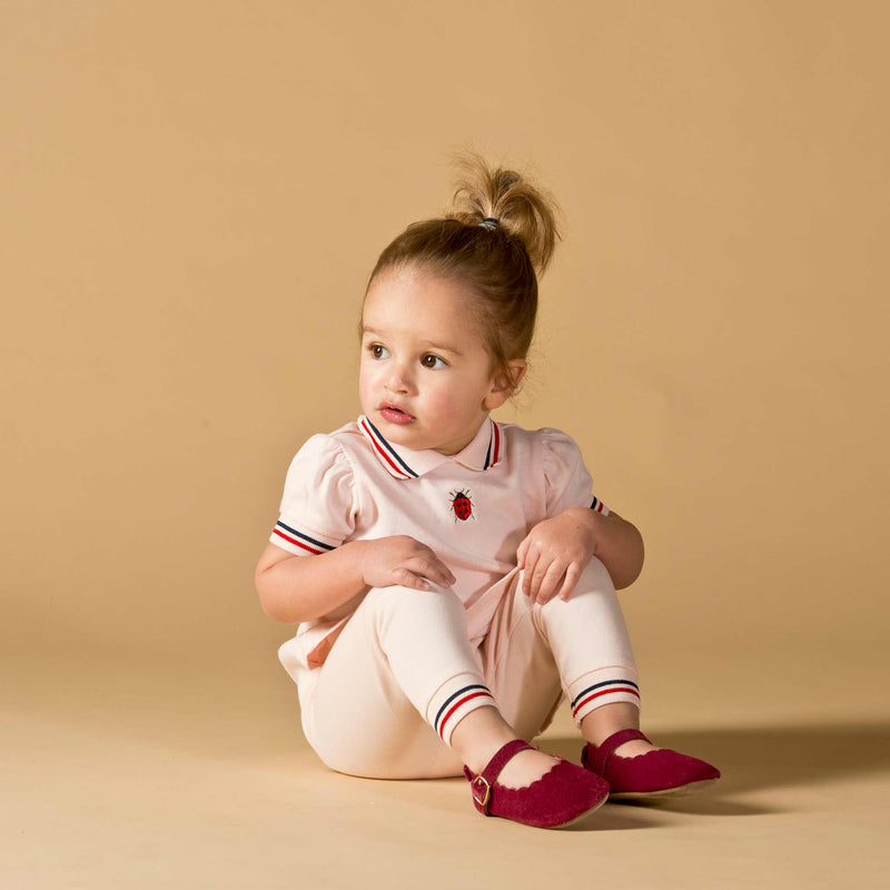 Girl wearing Oscar and Me pima cotton pink top and leggings