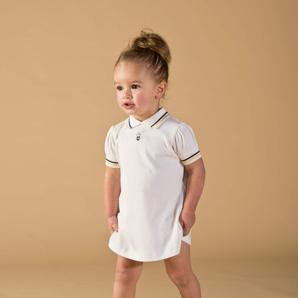 Girl wearing Oscar and Me pima cotton white dress and bloomers