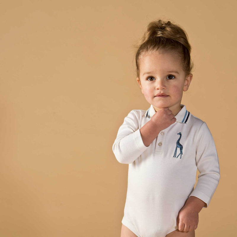 Girl wearing Oscar and Me pima cotton white onesie
